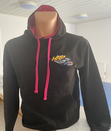 A jet black hooded top, with hot pink hooded lining and toggles